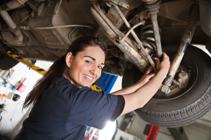 Mechanic checking tires