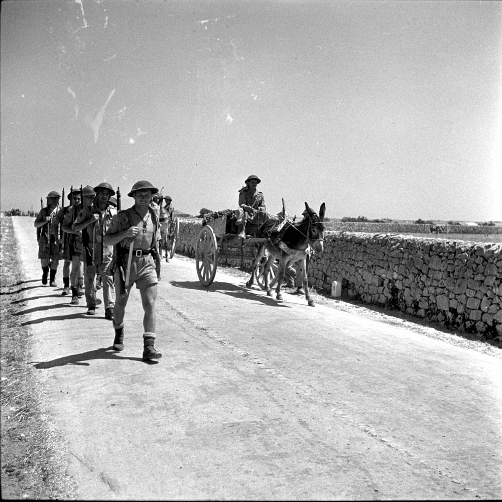 Canadian infantrymen on the march near Modica, Italy, 12 July 1943.