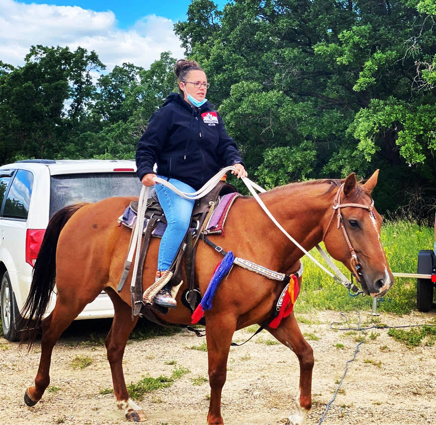 Helena riding her horse, Cruz