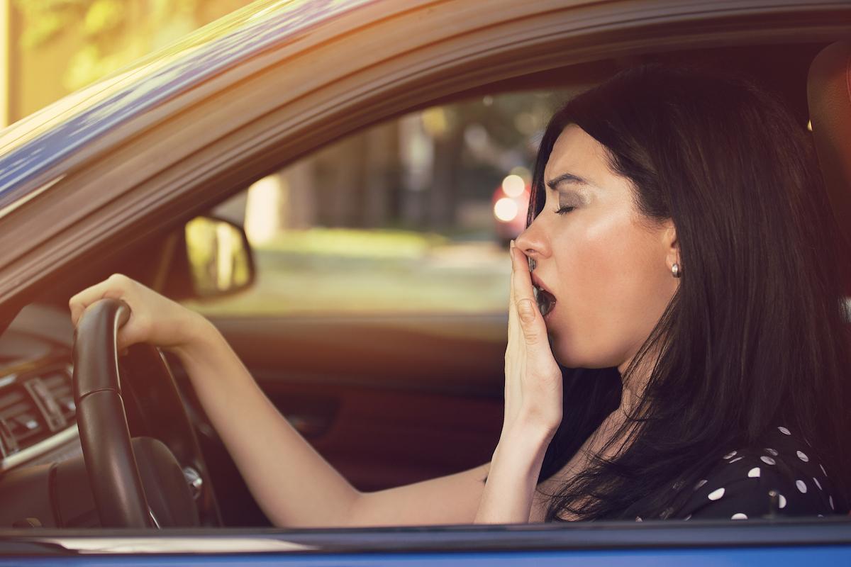 Sleepy Woman in Car